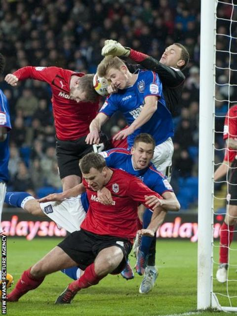 Cardiff City's Aaron Gunnarsson and Ben Turner challenge for a corner against Ipswich Town at Cardiff City Stadium
