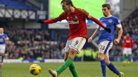 Michu comes closest to scoring for Swansea when his chip is pushed onto the bar by Everton goalkeeper Tim Howard