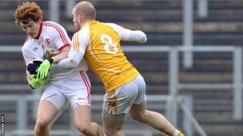 Tyrone's Peter McCann in action against Sean McVeigh of Antrim