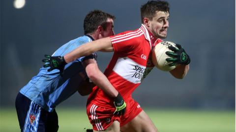 UUJ player Eoin Wade challenges Lee Kennedy of Derry during the McKenna Cup game at Celtic Park