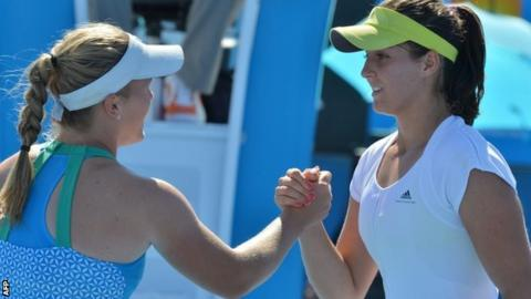 Laura Robson (right) shakes hands with Melanie Oudin after her first-round victory