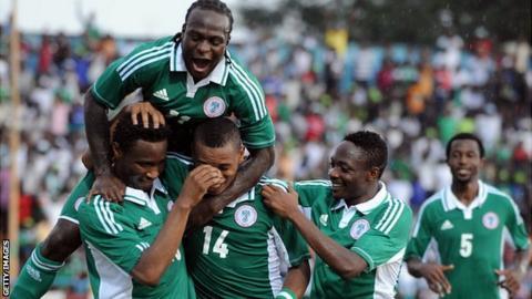 Nigeria's John Obi Mikel (L) celebrates with teammates