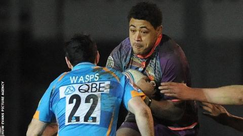 Toby Faletau takes on Stephen Jones