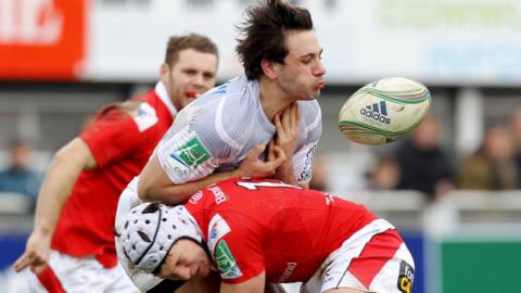 Remi Lamerat is tackled by Ulster's Michael Allen