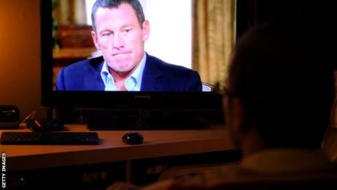 Lance Armstong on a TV screen