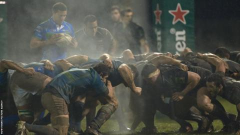 The Ospreys defend a scrum close to their try line amid difficult conditions at the Stadio Comunale di Monigo.