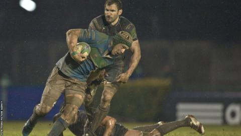 Treviso's Francesco Minto breaks free from Ospreys' Joe Bearman during a game in which the Italian side secured victory with two late tries.