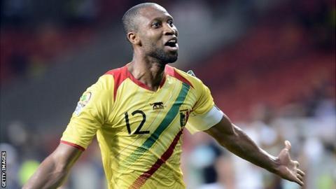 Mali's Seydou Keita celebrates scoring against Niger