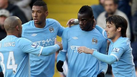 Mario Balotelli with Manchester City team mates, Nigel De Jong, Jerome Boatang, and David Silva.