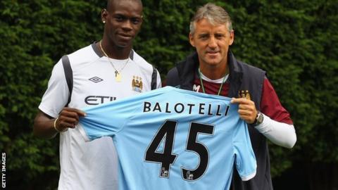 Mario Balotelli (left) and Roberto Mancini