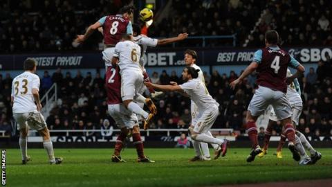 West Ham's Andy Carroll scores