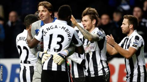 Tim Krul hugs Mapou Yanga-Mbiwa after the 3-2 win against Chelsea