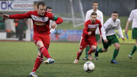 Cliftonville skipper George McMullan scores from the penalty spot to seal a 2-0 win over Donegal Celtic