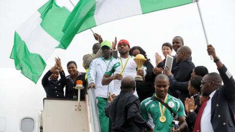 The Super Eagles team bring the Nations Cup onto Nigerian soil for the first time in 19 years