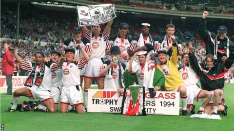 Swansea City players celebrate their Autoglass Trophy win in 1994