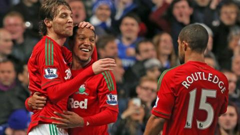 Swansea City's Michu celebrates a goal against Chelsea