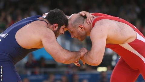 Uzbekistan's Artur Taymazov (R) wrestles Georgia's Davit Modzmanashvili in their Men's 120kg gold medal match at the London Olympics