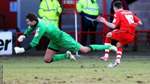 Notts County keeper Bartosz Bialkowski brings down Jamie Paterson for Walsall's first-half penalty
