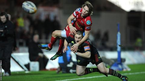 Scarlets wing Liam Williams is sent flying by Munster's Johne Murphy in Saturday's Pro12 encounter at Parc y Scarlets