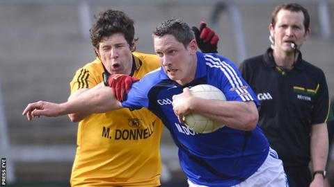Ulster's Sean Cavanagh battles with Munster's Gary Hurney