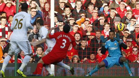 Liverpool's Jose Enrique scores past goalkeeper Michel Vorm as Swansea slump to a 5-0 defeat at Anfield
