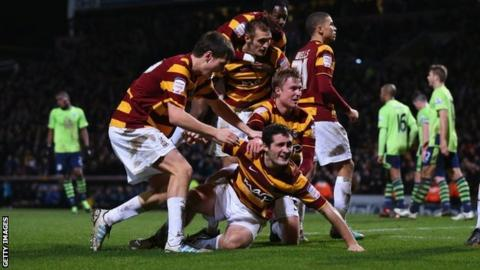 Bradford players celebrate scoring against Aston Villa