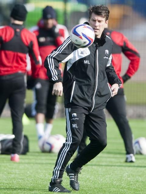 Swans boss Michael Laudrup shows his ball-control skills