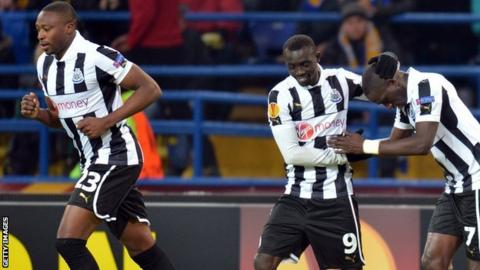 Newcastle celebrate their goal against Metalist Kharkiv