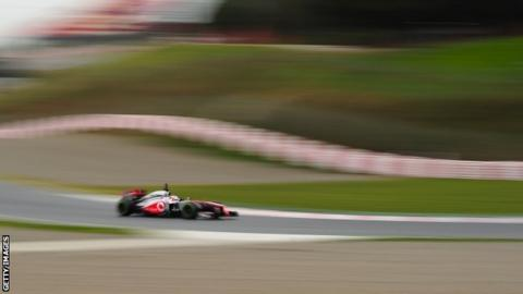 Jenson Button takes his McLaren for a spin at the Circuit de Catalunya