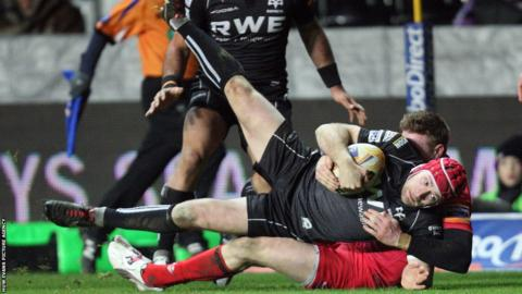 Full-back Richard Fussell is brought down but his initial break sets Ospreys up for their third and final try in a 24-7 win over Edinburgh
