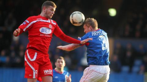 Portadown striker Darren Murray and Linfield defender David Armstrong in aerial action at Windsor Park