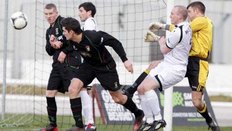 Glentoran's Jimmy Callacher saw his header cleared off the line during the match at Lisburn Distillery