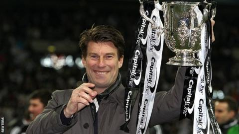 Swansea manager Michael Laudrup with the League Cup trophy