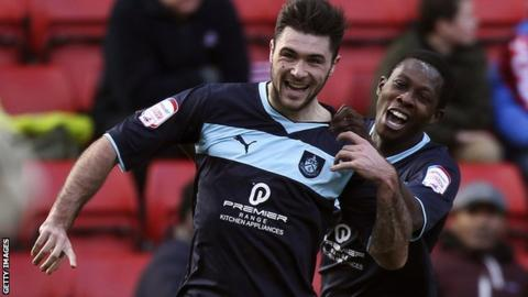 Burnley striker Charlie Austin (left)