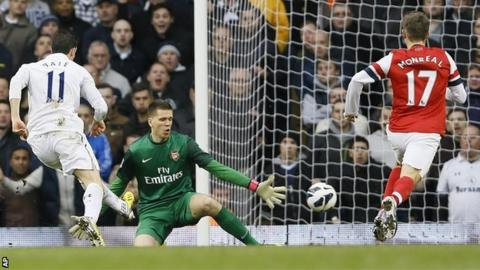 Tottenham forward Gareth Bale (left) scores against Arsenal