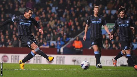 Carlos Tevez scores for Manchester City