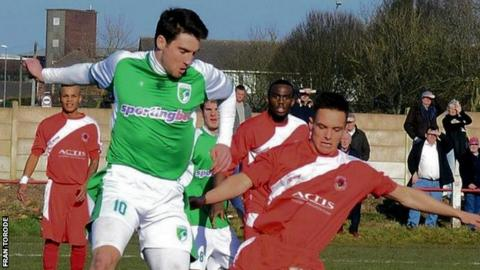 Guernsey striker Ross Allen takes on Walsall Wood