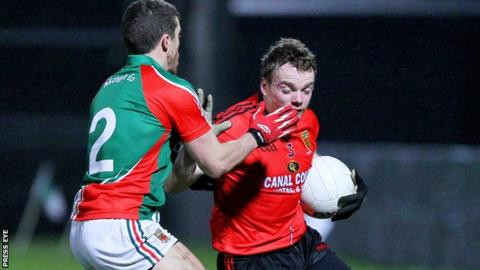 Mayo Chris Barrett challenges Brendan McArdle
