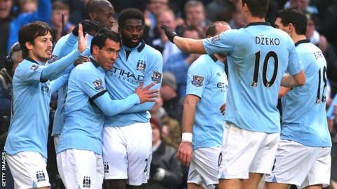 Manchester City celebrate their victory over Barnsley