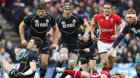 Scotland's centre Sean Lamont (left) is grounded during the defeat by Wales