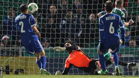 Israel keeper Dudu Aoute saved Steve Davis' close-range shot