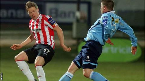 Derry's Simon Madden and Shelbourne's Philly Hughes