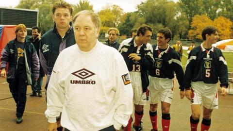 Craig Brown leads his Scotland side out