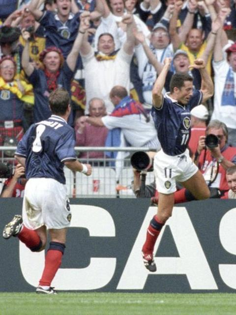 Scotland midfielder John Collins (right) celebrates in front of the Tartan Army