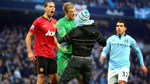 Rio Ferdinand, Gary Hart and Carlos Tevez deal with a fan