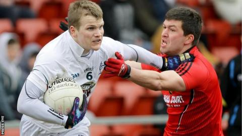 Kildare's Peter Kelly in action against Peter Turley of Down
