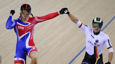 Sir Chris Hoy (left) celebrates with second placed Maximilian Levy (right) after winning the sprint final at the test event for London 2012 at the Olympic Velodrome