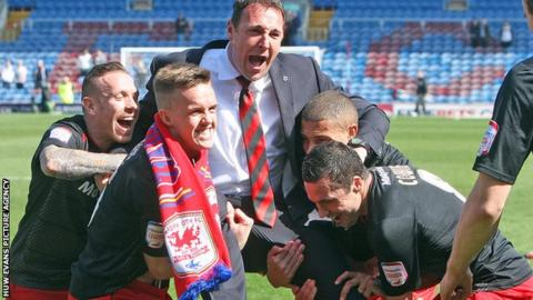 Malky Mackay celebrates winning the Championship title with his players