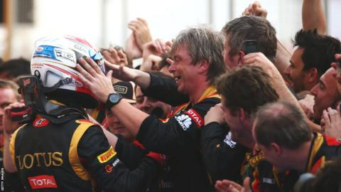 Romain Grosjean and Lotus pit crew celebrate