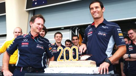 Mark Webber receives a cake from Red Bull colleagues to celebrate his 200th Grand Prix